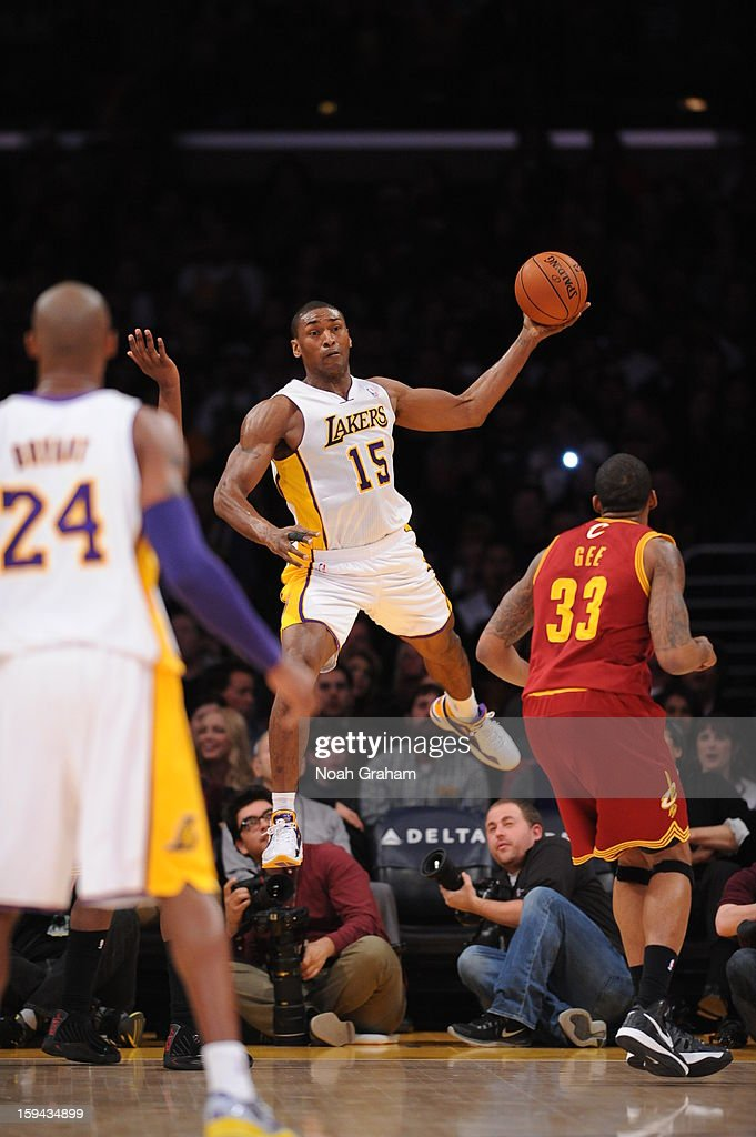 Metta World Peace #15 of the Los Angeles Lakers tries to save a ball from going out-of-bounds against Alonzo Gee #33 of the Cleveland Cavaliers at Staples Center on January 13, 2013 in Los Angeles, California.