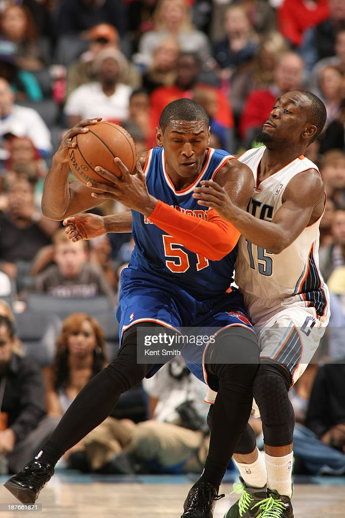 Metta World Peace #51 of the New York Knicks drives against Kemba Walker #15 of the Charlotte Bobcats during the game at the Time Warner Cable Arena on November 8, 2013 in Charlotte, North Carolina.