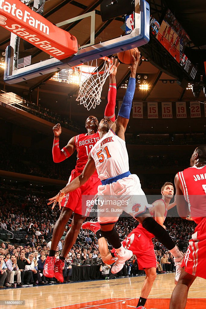 Metta World Peace #51 of the New York Knicks drives to the basket against <a gi-track='captionPersonalityLinkClicked' href=/galleries/search?phrase=Dwight+Howard&family=editorial&specificpeople=201570 ng-click='$event.stopPropagation()'>Dwight Howard</a> #12 of the Houston Rockets at Madison Square Garden in New York City on November 14, 2013.