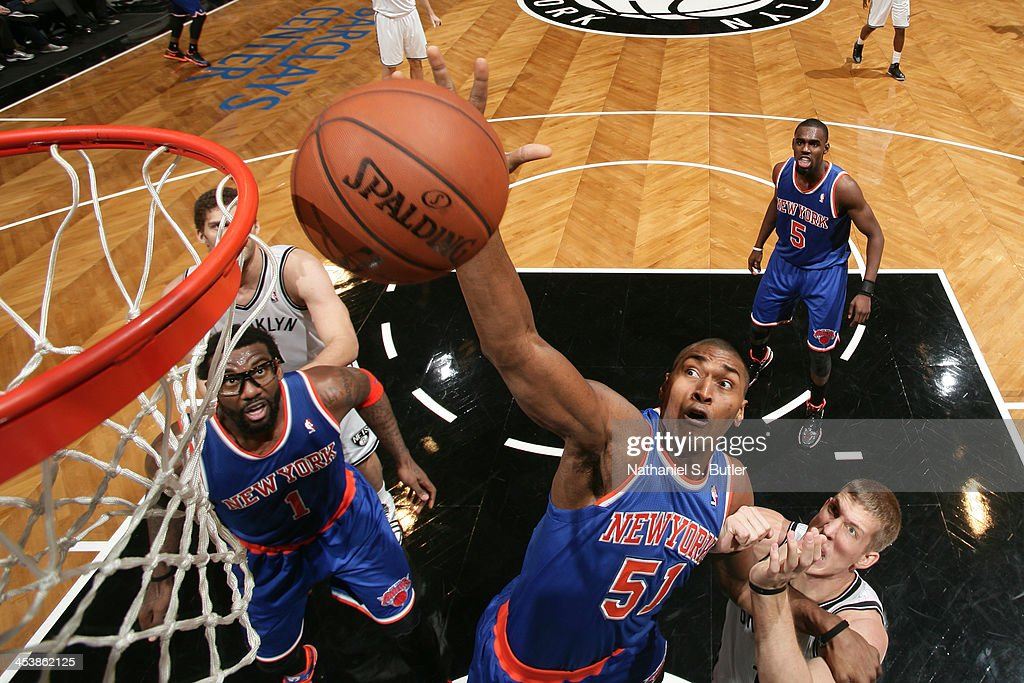 Metta World Peace #51 of the New York Knicks rebounds the ball during a game against the Brooklyn Nets at Barclays Center on December 5, 2013 in the Brooklyn borough of New York City.