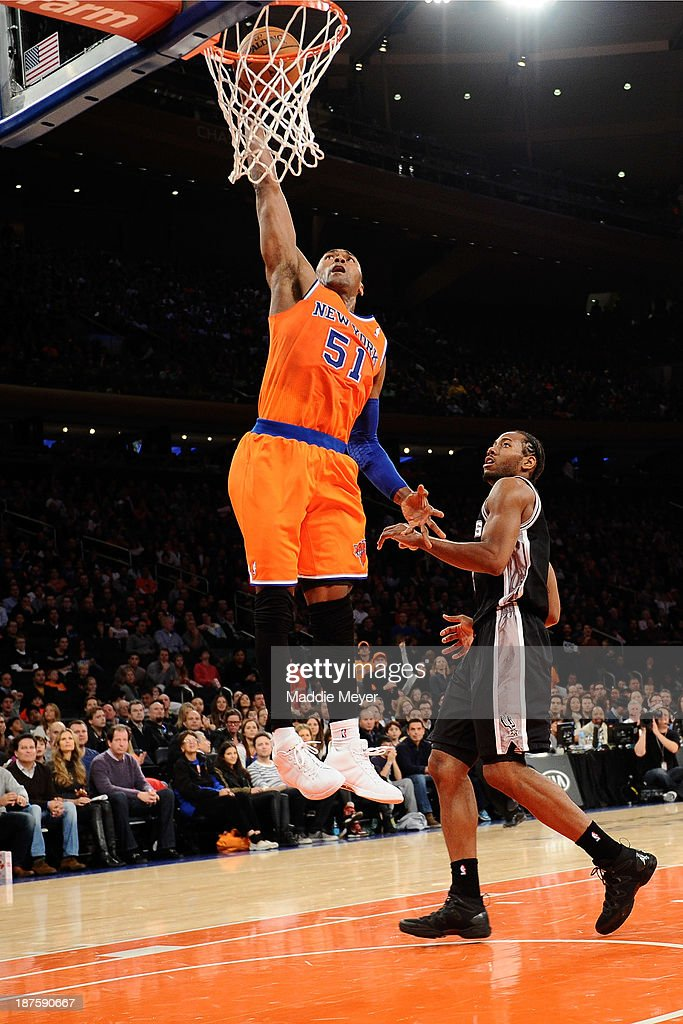 Metta World Peace #51 of the New York Knicks takes a shot over <a gi-track='captionPersonalityLinkClicked' href=/galleries/search?phrase=Kawhi+Leonard&family=editorial&specificpeople=6691012 ng-click='$event.stopPropagation()'>Kawhi Leonard</a> #2 of the San Antonio Spurs at Madison Square Garden on November 10, 2013 in New York City. The Spurs defeat the Knicks 120-89.