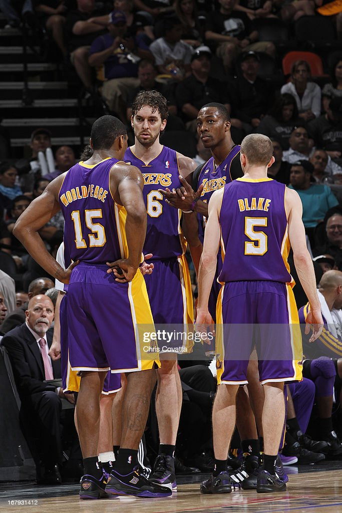 Metta World Peace #15, <a gi-track='captionPersonalityLinkClicked' href=/galleries/search?phrase=Pau+Gasol&family=editorial&specificpeople=201587 ng-click='$event.stopPropagation()'>Pau Gasol</a> #16, <a gi-track='captionPersonalityLinkClicked' href=/galleries/search?phrase=Dwight+Howard&family=editorial&specificpeople=201570 ng-click='$event.stopPropagation()'>Dwight Howard</a> #12 and <a gi-track='captionPersonalityLinkClicked' href=/galleries/search?phrase=Steve+Blake+-+Basketball+Player&family=editorial&specificpeople=204474 ng-click='$event.stopPropagation()'>Steve Blake</a> #5 of the Los Angeles Lakers huddle up during the game against the San Antonio Spurs in Game One of the 2013 NBA Playoffs at the AT&T Center on April 21, 2013 in San Antonio, Texas.
