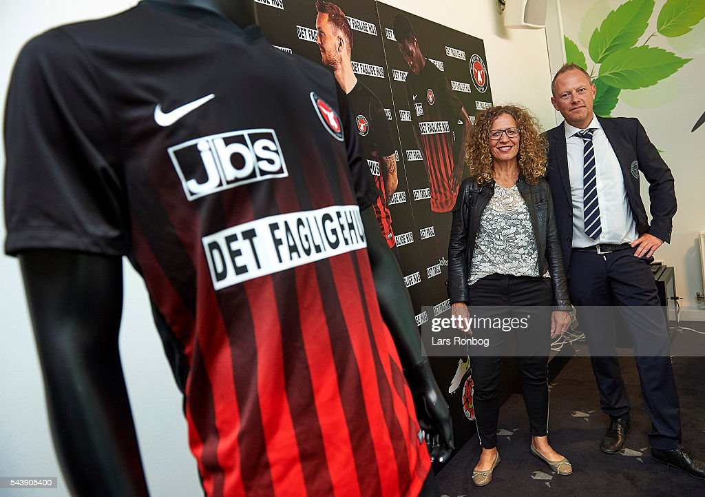 Mette Jul, head of communication of Det Faglige Hus and Jacob Jorgensen, head of marketing of FC Midtjylland present new shirt prior to the Europa League Qualifier match between FC Midtjylland and FK Suduva at MCH Arena on June 30, 2016 in Herning, Denmark.