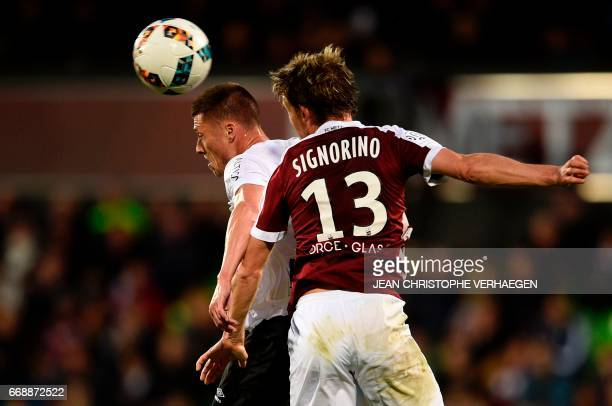 Metz' Cameroonian midfielder Georges Mandjeck vies for the ball with Caen's French forward Yann Karamoh during the French L1 football match between...