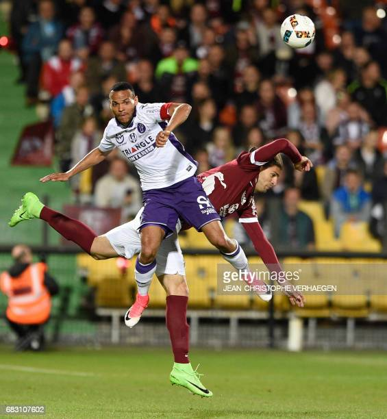 Metz' defender Ivan Balliu vies with Toulouse's forward Martin Braithwaite during the French L1 football match between Metz and Toulouse on May 14...
