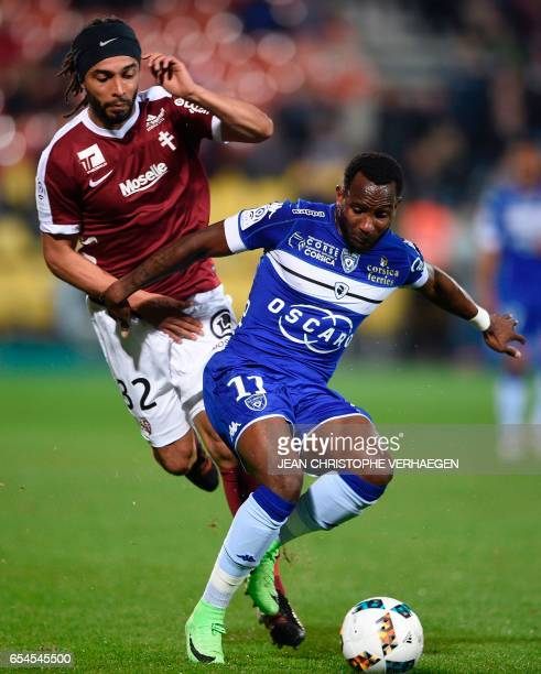 Metz' French defender Benoit AssouEkotto vies with Bastia's French midfielder Lenny Nangis during the French L1 football match between Metz and...