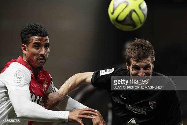 Metz' French defender Gaetan Bussmann vies with Monaco's Moroccan midfielder Nabil Dirar during the French L1 football match Monaco vs Metz on May 16...