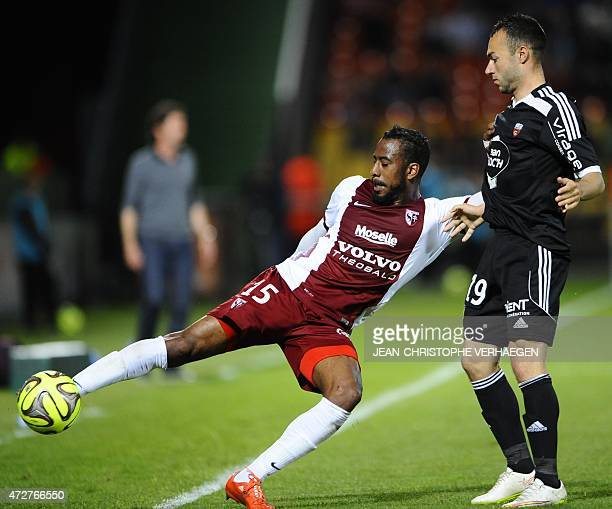 Metz' French defender Romain Metanire vies with Lorient's French midfielder Romain Philippoteaux during the French L1 football match between Metz and...