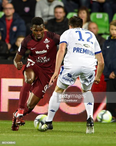Metz' French forward Opa Nguette vies with Troyes' French defender Mathieu Deplagne during the French L1 football match between Metz and Troyes on...