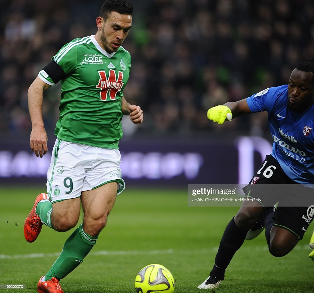 Metz' French Gabonese goalkeeper Anthony Mfa Mezui (R) vies for the ball with St Etienne's Turkish forward Mevlut Erding during the French L1 football match between Metz (FCM) and Saint-Etienne (ASSE) on March 14, 2015 at the Saint Symphorien stadium in Longeville-Les-Metz, eastern France.