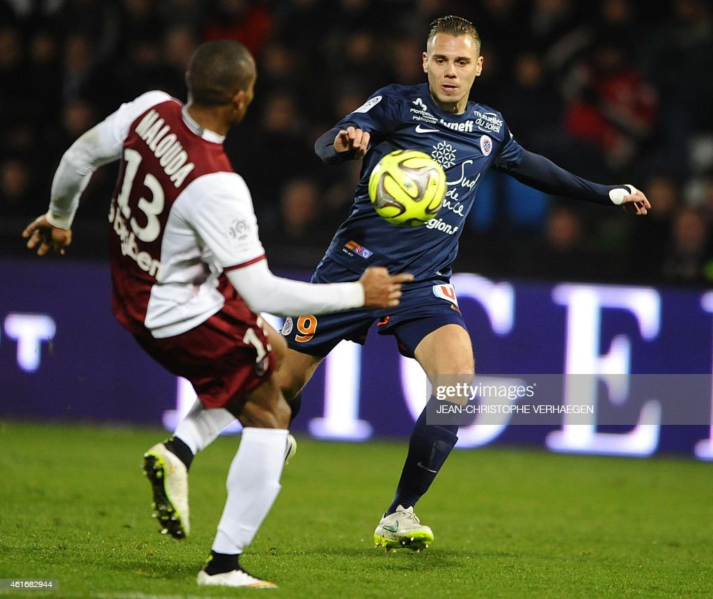 Metz' French midfielder <a gi-track='captionPersonalityLinkClicked' href=/galleries/search?phrase=Florent+Malouda&family=editorial&specificpeople=228109 ng-click='$event.stopPropagation()'>Florent Malouda</a> (L) vies with Montpellier's French forward Kevin Berigaud during the French L1 football match Metz vs Montpellier on January 17, 2015 at the Saint-Symphorien stadium in Longeville-Les-Metz.