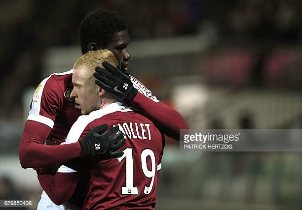 Metz' French midfielder Florent Mollet celebrates with teammate Metz' Senegalese midfielder Ismaila Sarr after scoring a goal during the French...