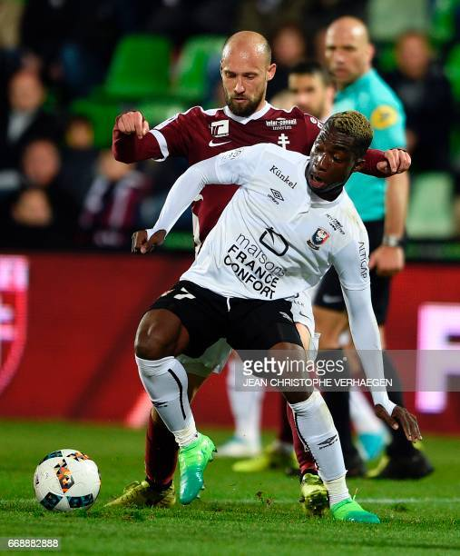 Metz' French midfielder Renaud Cohade vies for the ball with Caen's French forward Yann Karamoh during the French L1 football match between Metz and...