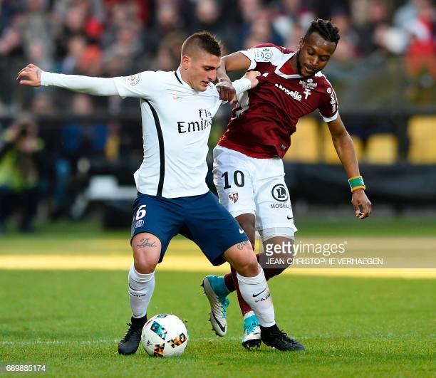Metz' Ivorian midfielder Cheick Doukoure vies for the ball with Paris SaintGermain's Italian midfielder Marco Verratti during the French L1 football...