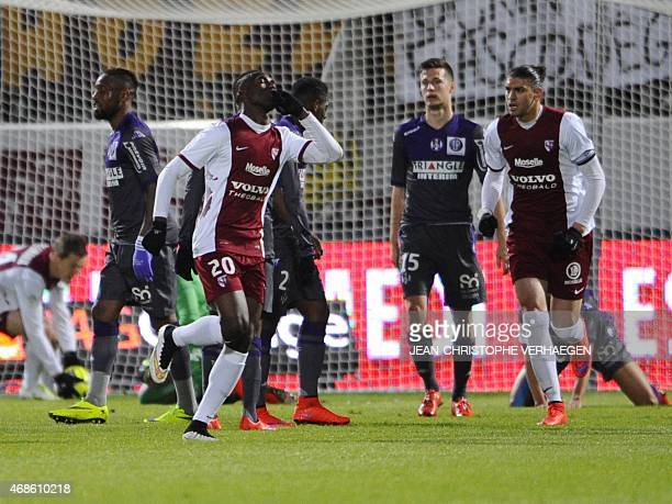 Metz' Malian forward Modibo Maiga celebrates after scoring during the French L1 football match between Metz and Toulouse on April 4 2015 at the Saint...