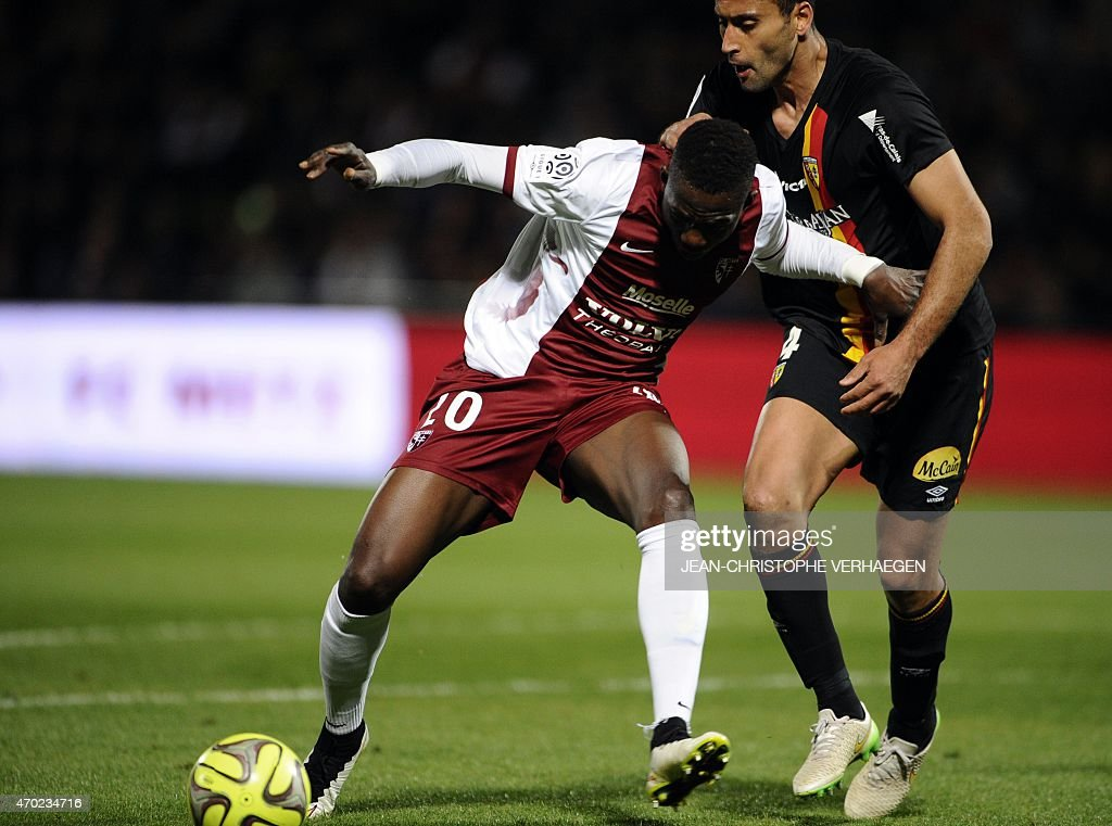 Metz' Malian forward Modibo Maiga (L) vies for the ball Lens' French defender Ahmed Kantari during the French L1 football match between Metz and Lens on April 18, 2015 at the Saint Symphorien stadium in Longeville-Les-Metz, eastern France.