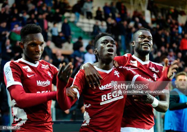 Metz' Senegalese midfielder Ismaila Sarr celebrates with teammates after scoring during the French L1 football match between Metz and Nancy at Saint...
