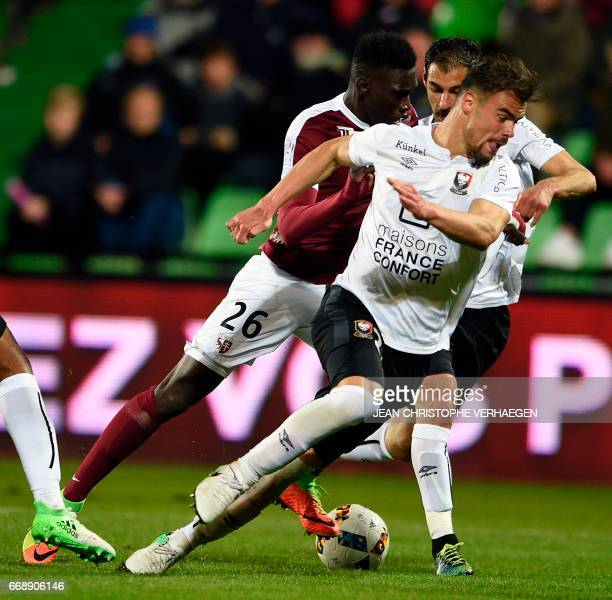 Metz' Senegalese midfielder Ismaila Sarr vies for the ball with Caen's French defender Damien Da Silva during the French L1 football match between...