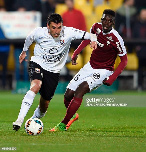 Metz' Senegalese midfielder Ismaila Sarr vies for the ball with Caen's French midfielder Julien Feret during the French L1 football match between...