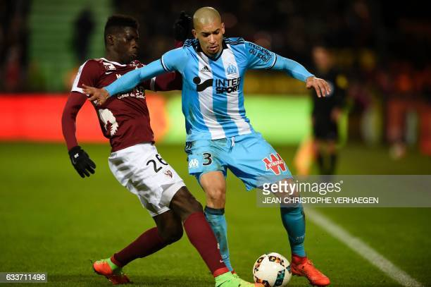 Metz' Senegalese midfielder Ismaila Sarr vies for the ball with Olympique de Marseille's Brazilian defender Matheus Doria Macedo during the French...