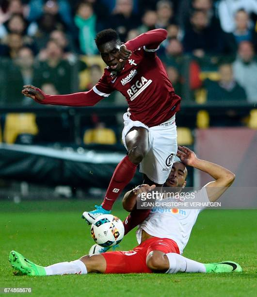 Metz' Senegalese midfielder Ismaila Sarr vies for the ball with Nancy's French defender Tobias Badila during the French L1 football match between...