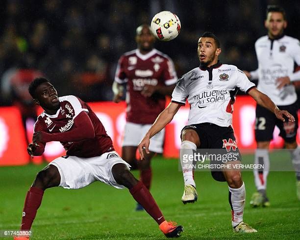 Metz' Senegalese midfielder Ismaila Sarr vies for the ball with Nice's Moroccan midfielder Younes Belhanda during the French L1 football match...