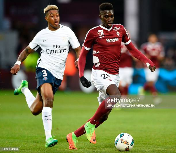 Metz' Senegalese midfielder Ismaila Sarr vies for the ball with Paris SaintGermain's French defender Presnel Kimpembe during the French L1 football...