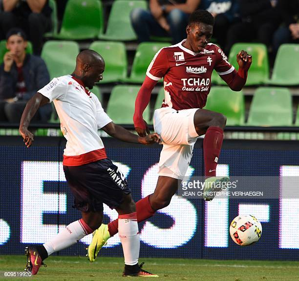 Metz' Senegalese midfielder Ismaila Sarr vies for the ball with Bordeaux' French defender Youssouf Sabaly during the French L1 football match between...