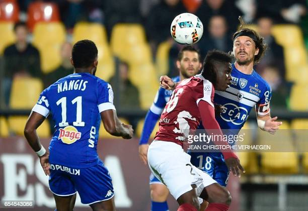 Metz' Senegalese midfielder Ismaila Sarr vies with Bastia's French midfielder Yannick Cahuzac and Bastia's French midfielder Lenny Nangis during the...