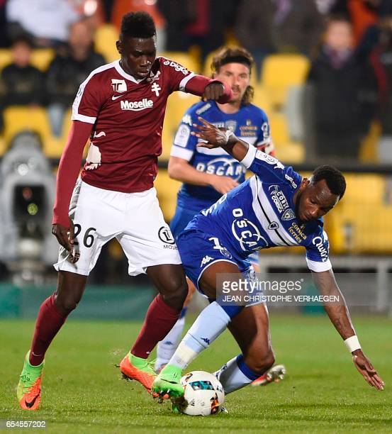 Metz' Senegalese midfielder Ismaila Sarr vies with Bastia's French midfielder Lenny Nangis during the French L1 football match between Metz and...