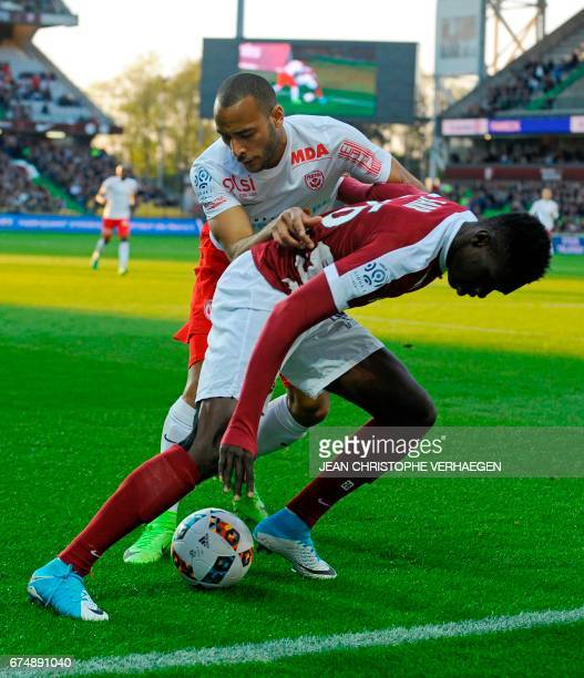 Metz' Senegalese midfielder Ismaila Sarr vies with Nancy's French defender Tobias Badila during the French L1 football match between Metz and Nancy...