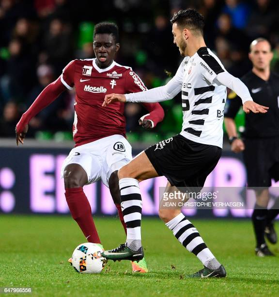 Metz' Senegalese midfielder Ismaila Sarr vies with Rennes' Algerian defender Ramy Bensebaini during the French L1 football match between Metz and...