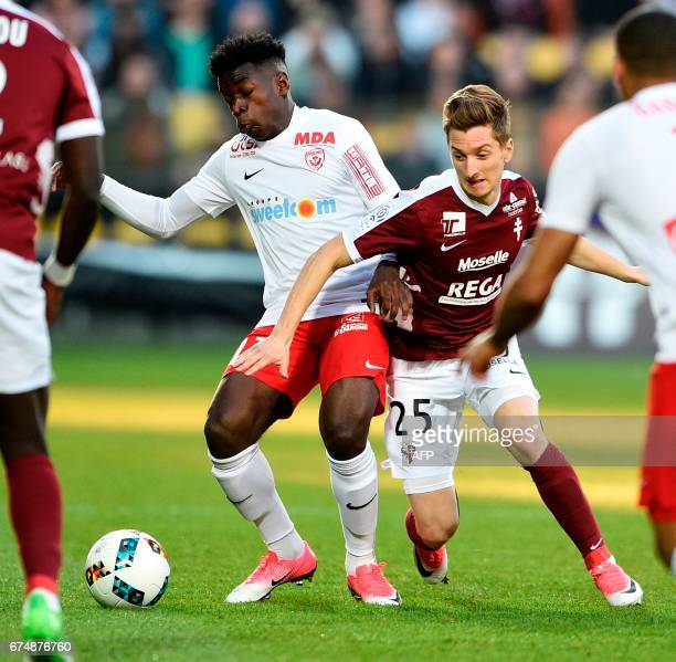 Metz' Spanish defender Ivan Balliu vies for the ball with Nancy's French defender Faitout Maouassa during the French L1 football match between Metz...
