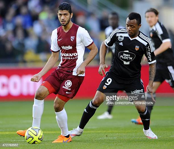Metz' Tunisian midfielder Ferjani Sassi is challenged for the ball by Lorient's Ghanaian forward Jordan Ayew during the French L1 football match...