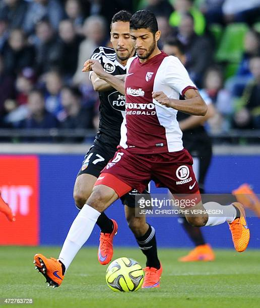 Metz' Tunisian midfielder Ferjani Sassi is challenged for the ball by Lorient's French Algerian midfielder Walid Mesloub during the French L1...
