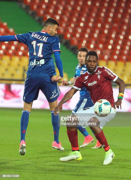 Metz's Cameroon midfielder Georges Mandjeck vies with Lyon's French Algerian midfielder Rachid Ghezzal during the French Ligue 1 football match...