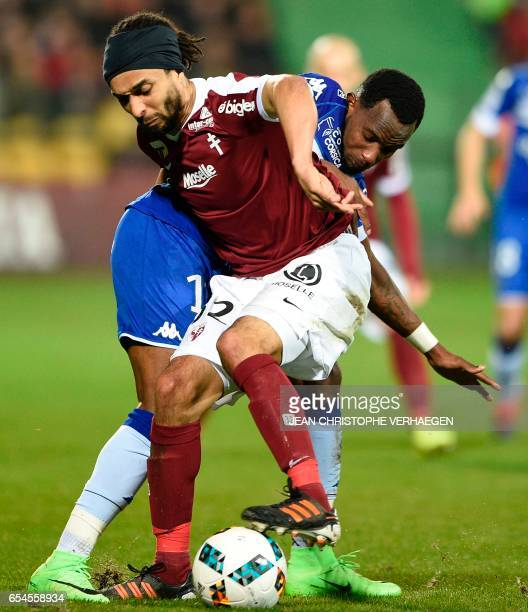 Metz's French defender Benoit AssouEkotto vies Bastia's French midfielder Lenny Nangis during the French L1 football match between Metz and Bastia on...