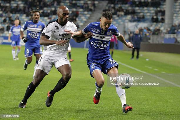 Metz's French defender Jonathan Rivierez vies with Bastia's French midfielder Gael Danic during the French L1 football match between Bastia and Metz...