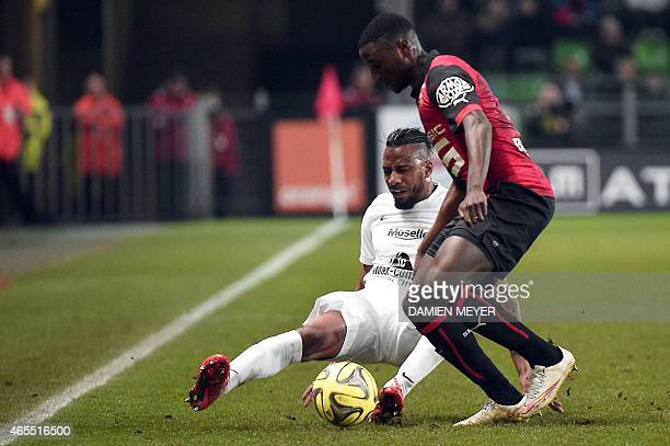 Metz's French defender Romain Metanire challenges Rennes' French forward PaulGeorges Ntep during the French L1 football match between Rennes and Metz...