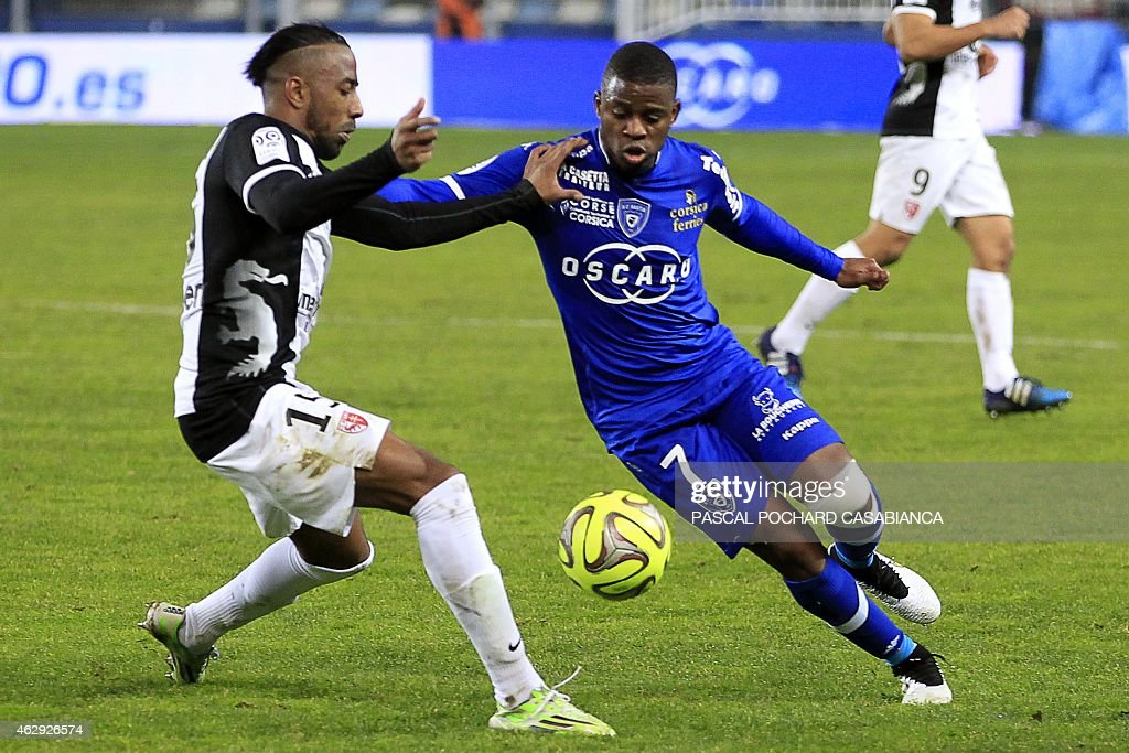 Metz's French defender Romain Metanire (L) vies for the ball with Bastia's French midfeilder <a gi-track='captionPersonalityLinkClicked' href=/galleries/search?phrase=Floyd+Ayite&family=editorial&specificpeople=5969808 ng-click='$event.stopPropagation()'>Floyd Ayite</a> during the French L1 football match Bastia (SCB) vs Metz (FCM) on February 7, 2015 at the Armand Cesari stadium in Bastia, French Mediterranean island of Corsica.
