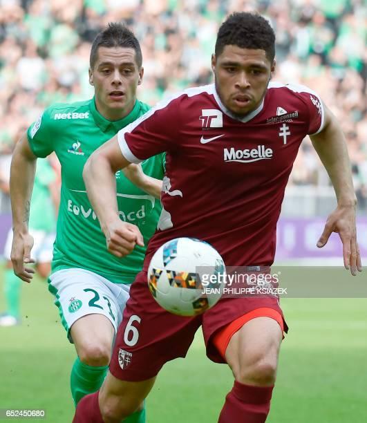 Metz's French defender Simon Falette outruns SaintEtienne's French midfielder Romain Hamouma during the French L1 football match SaintEtienne vs Metz...