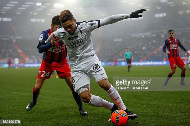 Metz's French defender Simon Falette vies with Caen's French defender Frederic Guilbert during the French L1 football match between Caen and Metz on...