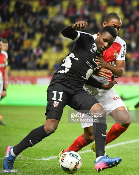 Metz's French forward Opa Nguette challenges Monaco's French defender Abdou Diallo during the French Ligue 1 football match between AS Monaco and...