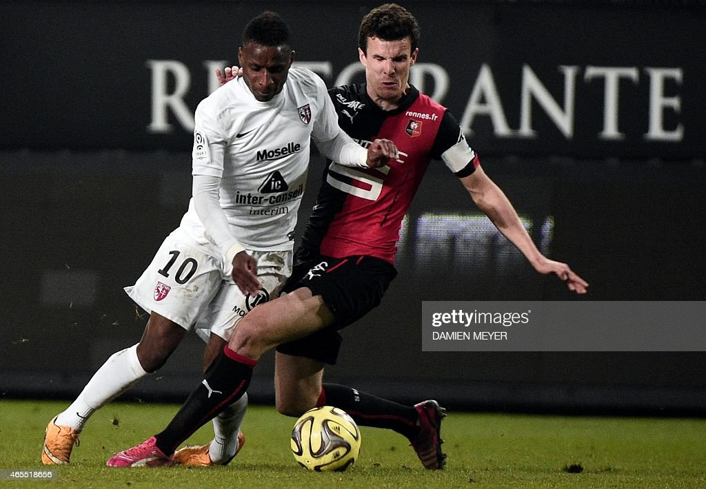 Metz's French midfielder Bouna Sarr (L) vies with Rennes' French defender <a gi-track='captionPersonalityLinkClicked' href=/galleries/search?phrase=Romain+Danze&family=editorial&specificpeople=4121826 ng-click='$event.stopPropagation()'>Romain Danze</a> during the French L1 football match between Rennes and Metz on March 7, 2015 at the route de Lorient stadium in Rennes, western France.