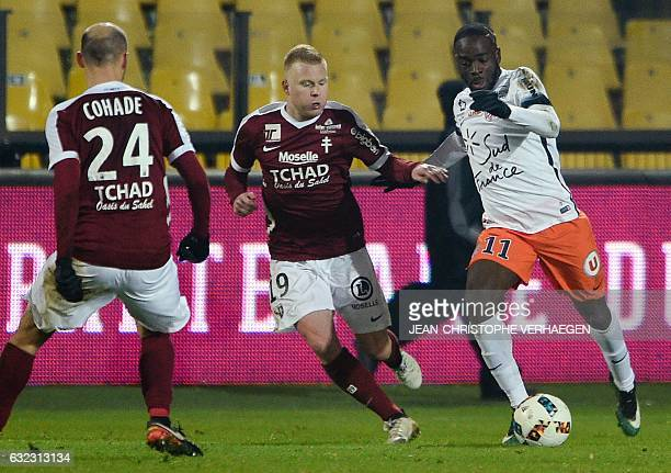 Metz's French midfielder Florent Mollet and Metz's French midfielder Renaud Cohade vie with Montpellier's French midfielder Jonathan Ikone during the...