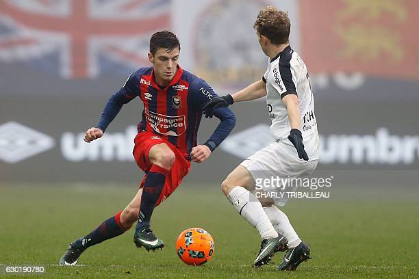 Metz's French midfielder Gauthier Hein vies with Caen's French defender Frederic Guilbert during the French L1 football match between Caen and Metz...
