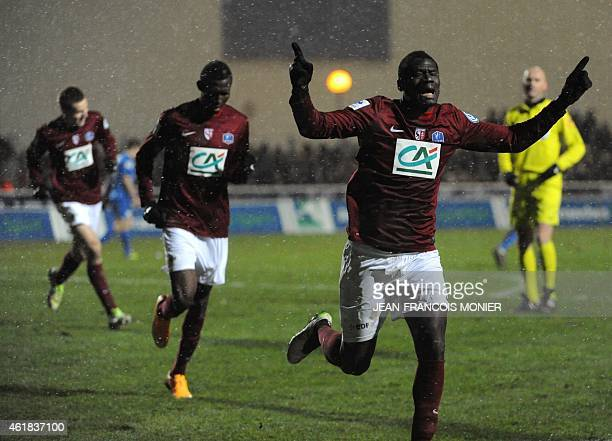 Metz's French midfielder Guirane N'Daw celebrates after scoring during the French Cup football match between US Avranches Mont Saint Michel vs FC...