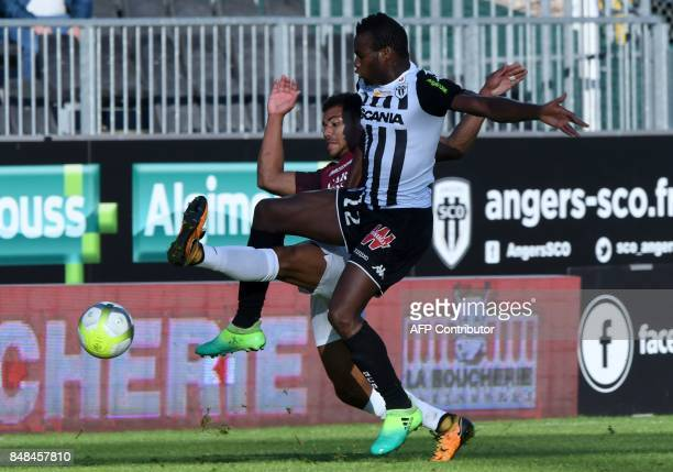 Metz's French midfielder Kevin Lejeune vies for the ball with Angers' Malian midfielder Lassana Coulibaly during the French L1 football match between...