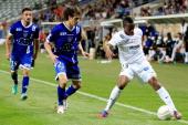 Metz's midfielder Yeni Atito Ngbakoto vies with Bastia's Algerian defender Fethi Harek during the French League Cup Football match Bastia vs FC Metz...