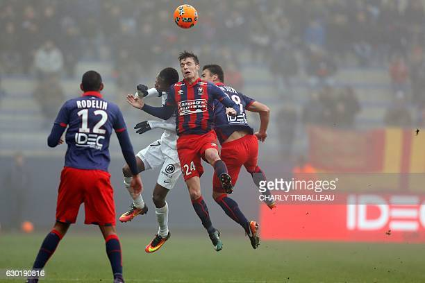 Metz's Senegalese forward Habib Diallo vies with Caen's French defender Frederic Guilbert and Caen's French defender Damien Da Silva during the...